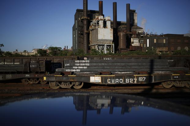 Steel slabs sit on flatcars after being manufactured at the ArcelorMittal steel mill complex in Cleveland, Ohio. Photo: Luke Sharrett/Bloomberg
