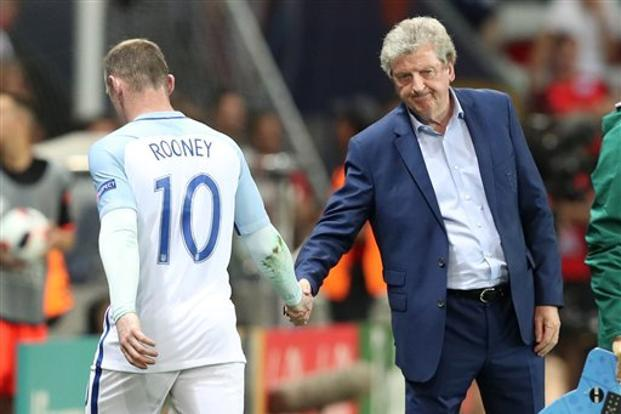 England coach Roy Hodgson salutes Wayne Rooney as he leaves the pitch to be replaced during the Euro 2016 round of 16 match between England and Iceland in Nice, France on Monday. Photo: AP