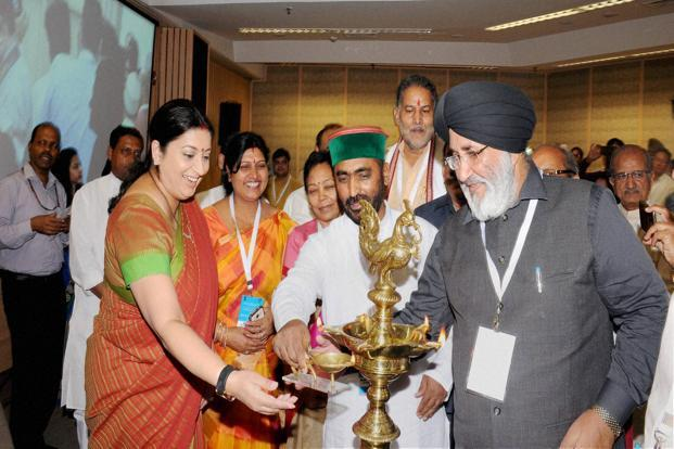 HRD minister Smriti Irani is lighting the lamp at the launch of a teacher education portal in New Delhi on Thursday. Photo: PTI