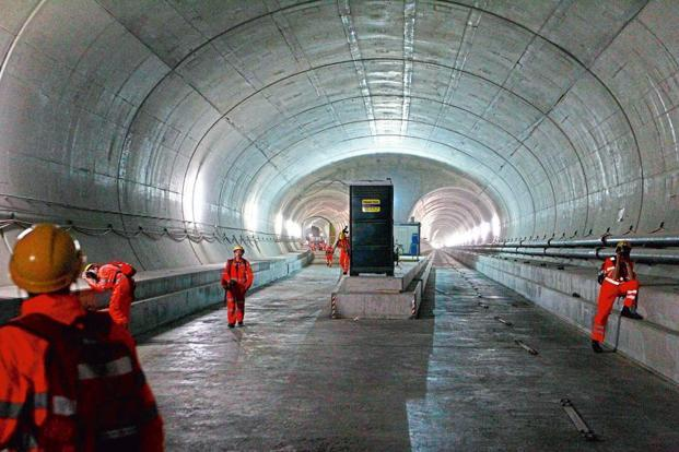 The Gotthard Base Tunnel being constructed. Photographs by Arnd Wiegmann/Reuters & The Swiss do it again - Livemint