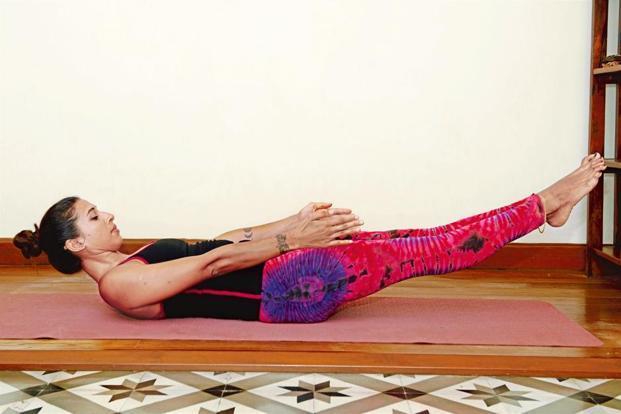 Naukasana helps improve digestion and blood flow. Photographs by Aniruddha Chowdhury/Mint