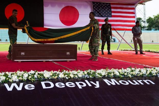 At the ceremony, the caskets, bearing the flags of India, Italy, Bangladesh, Japan and the US—signifying the nationalities of the victims—were placed on a raised platform and Sheikh Hasina placed floral wreaths on the caskets of the victims. Photo: AP