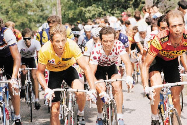Greg LeMond of the US (left) and five-time winner Bernard Hinault of France during the 1986 Tour de France. It was widely believed that LeMond was being groomed as Hinault's successor in the La Vie Claire team. Hinault took keen interest in LeMond's development. Photo: AP