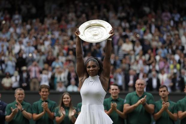 Serena Williams beat Angelique Kerber 7-5, 6-3 in Saturday's Wimbledon final, her 22nd major title, tied with Steffi Graf for most in the Open Era. Photo: Reuters