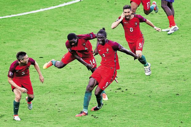 Éder (centre), who entered the game as a substitute, with his Portugal teammates after scoring the only goal in the Euro 2016 final. Photo: Alex Livesey/Getty Images