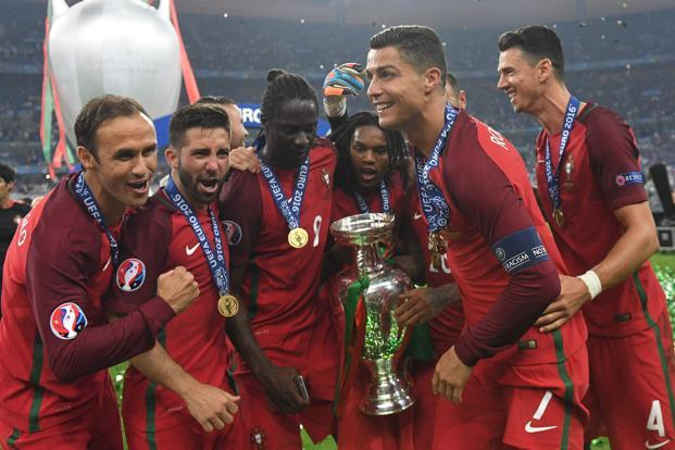 Team Portugal posing with the trophy on the pitch after they won the Euro 2016 final football match between Portugal and France at the Stade de France in Saint-Denis, Paris, on 10 July, 2016. Photo: AFP