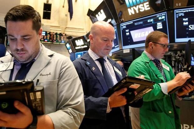 Record-breaking S&P 500, Dow rally stalls on oil drop