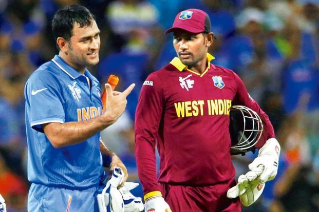 M.S. Dhoni with West Indies' wicket keeper Denesh Ramdin. Photo: Reuters