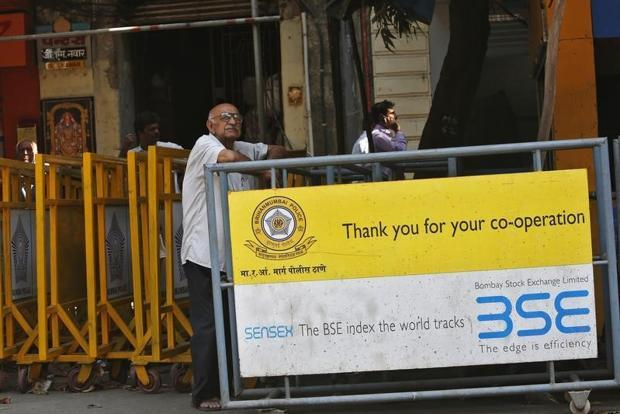 Markets open flat on mixed global cues