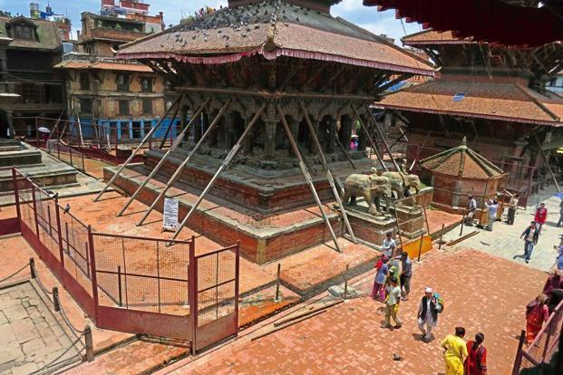 The 1627 Vishveshvara temple has been shored up. Shoring is typically done to prevent unnecessary demolition, permitting assessments to determine repair methods. Here, reinforcement of the structure is being prioritized over dismantling.