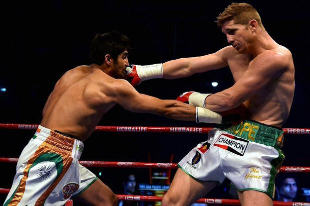 Vijender Singh (left) seemed to be looking for a knockout blow from the very beginning even though Kerry Hope was the more attacking of the two. Photo: PTI
