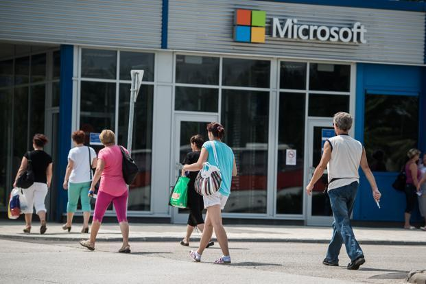 Microsoft shares were up 4.35% at $55.40 in extended trading on Tuesday.  Photo: Bloomberg