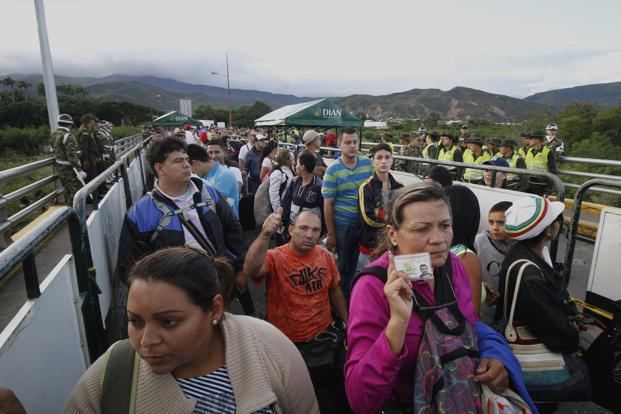 Venezuelans crossing the Simon Bolivar bridge into Cucuta, Colombia, on Sunday. Photo: Bloomberg