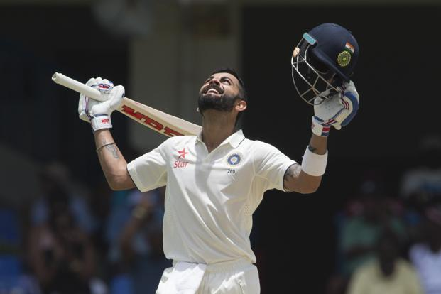 Virat Kohli celebrates after batting 200 runs during day two of the cricket test match between West Indies and India on Friday. Photo: Don Emmert/AFP