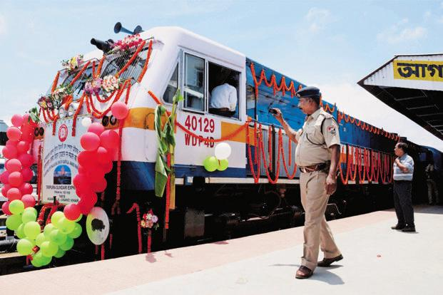 A security personnel clicks a picture of the Tripura Sundari Express, a weekly train connecting Agartala and New Delhi, during the flag-off ceremony at the Agartala railway station on Sunday. Photo: PTI