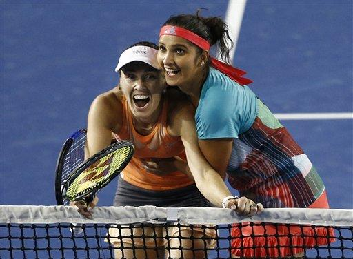 Sania Mirza will now play with world number 21 Barbora Strycova from the Czech Republic while Martina Hingis has teamed up with Coco Vandeweghe of the United States of America. Photo: AP