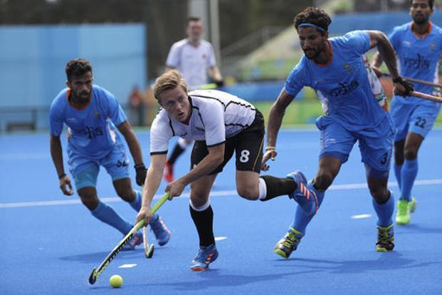 Germany's Mats Grambusch fights for the ball against India's Rupinder Pal Singh during a men's field hockey match at 2016 Summer Olympics in Rio de Janeiro, Brazil. Photo: AP