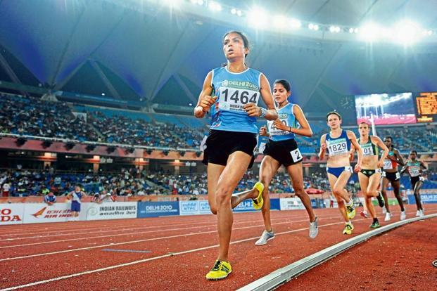 Kavita Raut (in the lead) in the 2010 Commonwealth Games. Photo: William West/AFP