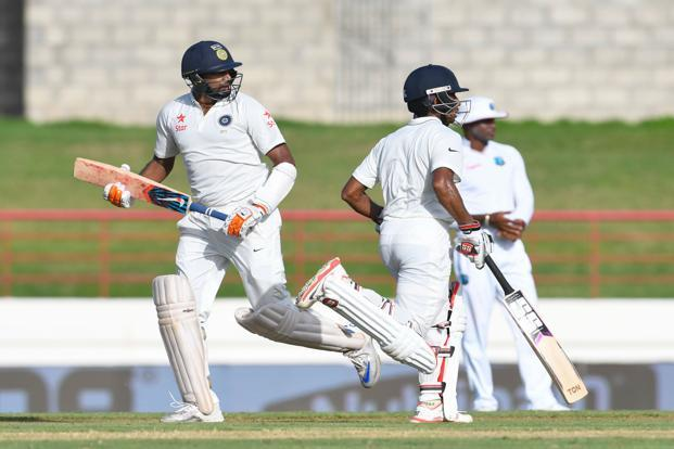 Ravichandran Ashwin (left) and Wriddhiman Saha (right) during first day of the third Test between West Indies and India at Darren Sammy National Stadium in St. Lucia on Tuesday. Photo: AFP