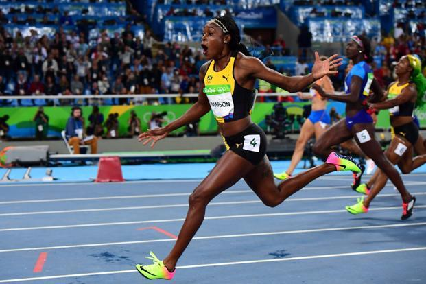 Jamaica's Elaine Thompson celebrates winning the Women's 100m final during  the athletics event at the Rio