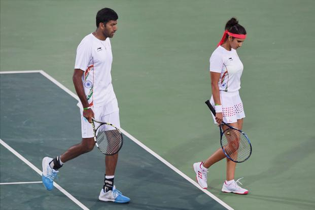 Sania Mirza and Rohan Bopanna leave the ground after losing the mixed-doubles match against the Czech team of Radek Stepanek and Lucie Hradceka. Photo: PTI