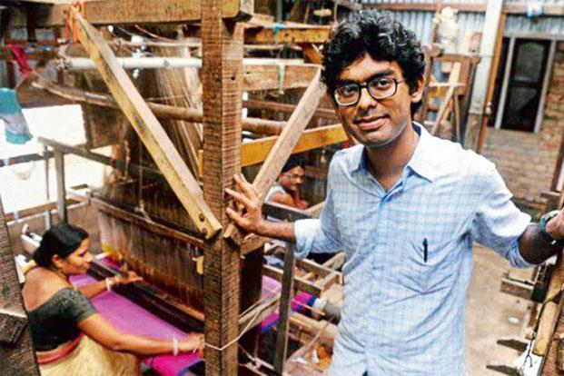 Designer Santanu Das with weavers in Santipur, West Bengal.
