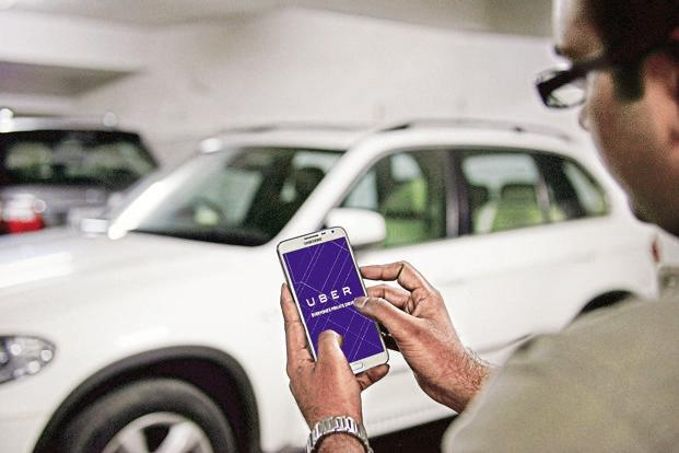 Globally, Uber enables direct, automatic deductions on consumer's credit cards stored in the app. Photo: Hemant Mishra/Mint