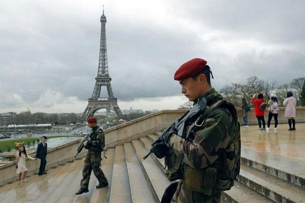 French army paratroopers patrolling near the Eiffel Tower in Paris, France, in March. Photo: Philippe Wojazer/Reuters