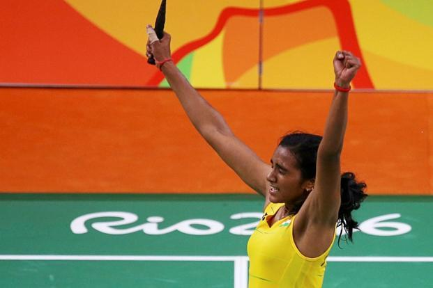 P.V. Sindhu celebrates after winning her match against Nozomi Okuhara of Japan in the women's badminton singles semi-final in Rio de Janeiro on Thursday. Photo: Reuters