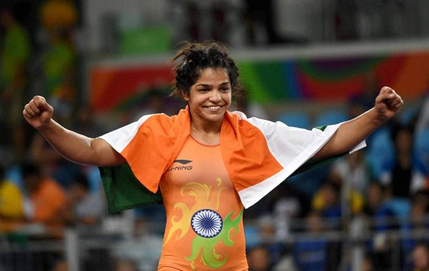Wrestler Sakshi Malik celebrates after beating Kyrgyzstan's Aisuluu Tynybekova to win the bronze in the women's wrestling freestyle 58kg competition at the 2016 Rio Olympics. Photo: PTI