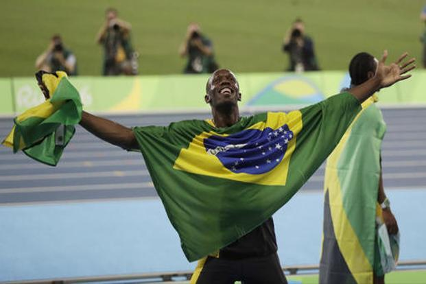 Usain Bolt holds the flag of Brazil after winning the gold medal in the men's 4x100-metre relay final during the athletics competitions of the 2016 Summer Olympics at the Olympic stadium in Rio de Janeiro on Friday. Photo: AP