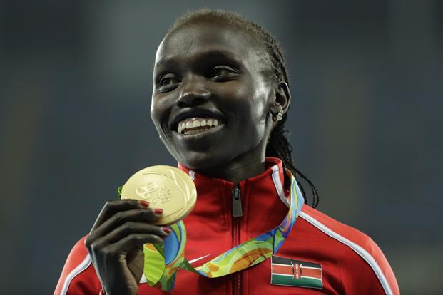 Kenya's Vivian Jepkemoi Cheruiyot celebrates winning the women's 5000-meter final, during the athletics competitions of the 2016 Summer Olympics at the Olympic stadium in Rio de Janeiro on Friday. Photo: AP