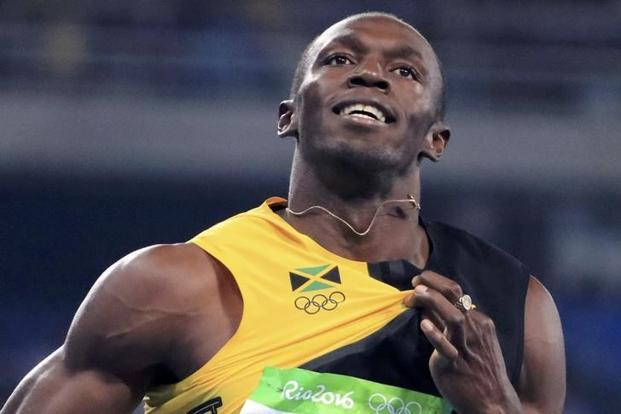 Usain Bolt of Jamaica celebrates after the team won the relay race. Photo: Reuters