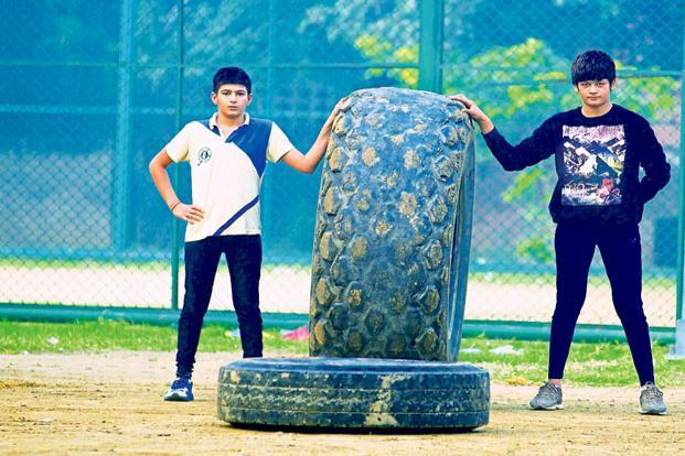 Budding wrestlers Khushi Ahlawat (left) and Mansi Ahlawat. At the Chhotu Ram Stadium in Rohtak, Haryana, the signs of camaraderie are everywhere—in the clothes and the dreams they share. Photo: Priyanka Parashar/Mint