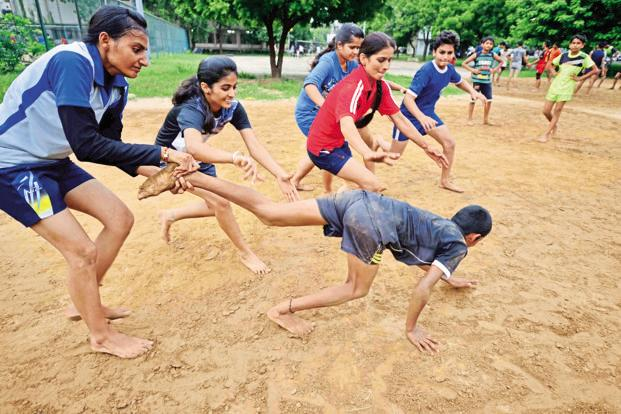 Children play kabaddi at the Sir Chhotu Ram Stadium in Rohtak. Haryana's sports policy for 2016-17 lists many ambitious plans, including the development of mini stadiums in each gram panchayat. Photo: Pradeep Gaur/Mint