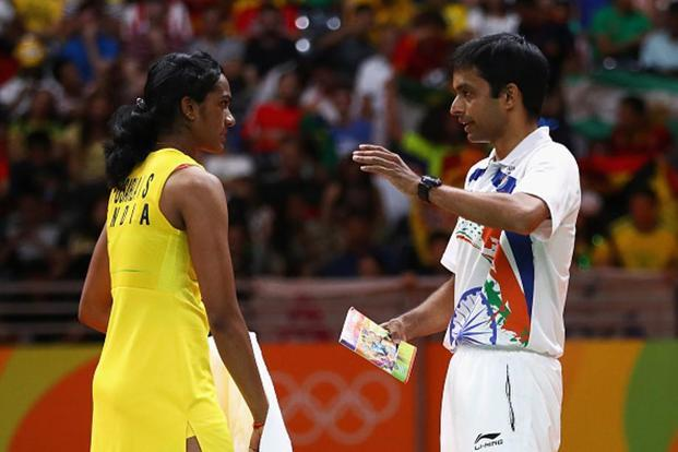 P.V. Sindhu with coach Pullela Gopi Chand. Photo: Clive Brunskill/Getty Images