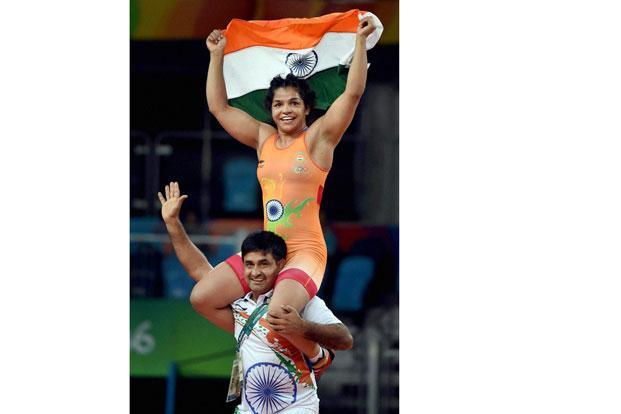 Sakshi Malik with Ishwar Dahiya. Photo: Atul Yadav/PTI