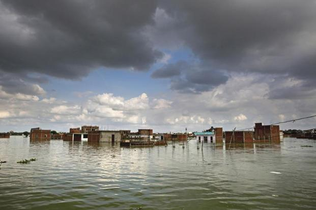photo essay state of flood livemint houses partially submerged in allahabad on sunday photos pti