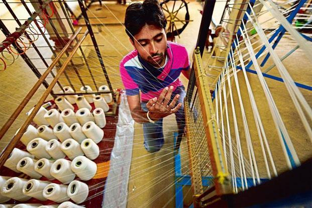 A young weaver of Malharganj at work