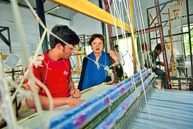 Sally Holkar at a student's loom on the THS campus