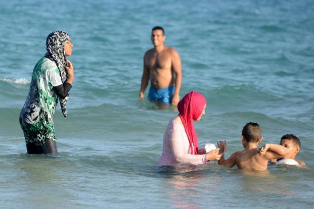 The French see the burkini as yet another piece of Muslim clothing that restricts women and forces them to hide their bodies. Photo: AFP