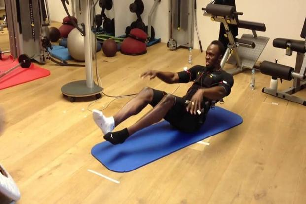 Usain Bolt is known to use electronic muscle stimulation (EMS) which stimulates the muscles with an electrical current that runs through the pads or clothing that touch the skin which overrides that natural energy-retaining mechanism, causing all the motor neurons to fire at once and creating up to 30% more tension in the muscle.