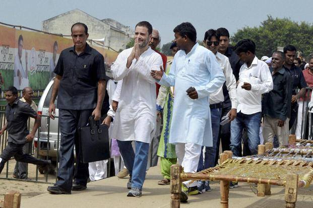 Congress vice president Rahul Gandhi at 'khaat pe charcha' programme for the launch of his kisan yatra for upcoming UP polls, in Deoria on Tuesday. Photo: PTI