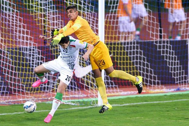 Gurpreet Singh Sandhu (in yellow) in action during the Fifa World Cup 2018 qualifying match against Iran. Photo: Manjunath Kiran/AFP