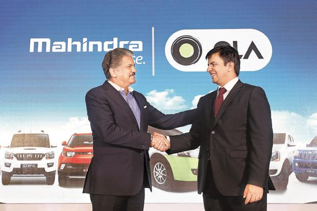 Mahindra Group chairman Anand Mahindra (left) and Ola CEO Bhavish Aggarwal. The alliance seeks to encourage micro-entrepreneurship among drivers to address India's growing mobility needs. Photo: Danish Siddiqui/Reuters