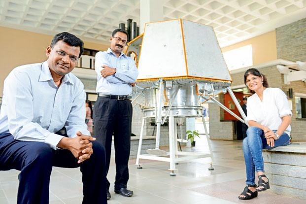 A file photo of Team Indus members Rahul Narayan, Ramnath Babu and Sheelika Ravishankar with a prototype lander that will land on the moon and send data back home. Photo: Hemant Mishra/Mint