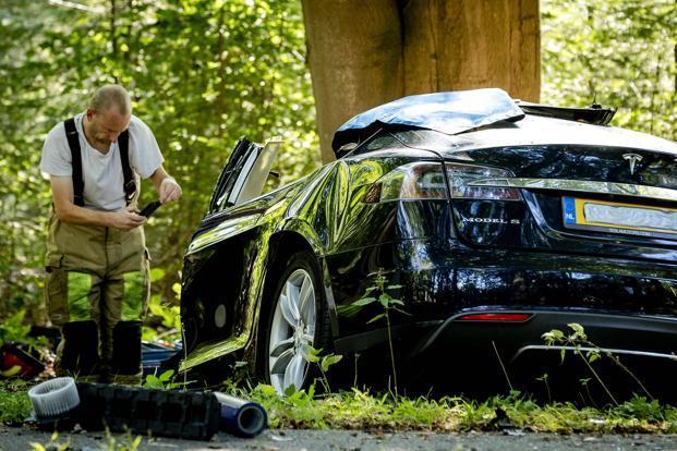 Tesla probes Dutch fatal crash,  says auto pilot not on
