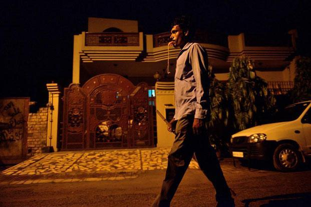Dilip Bharti works as a security guard in a housing colony in Ghaziabad. Photographs by Pradeep Gaur/Mint
