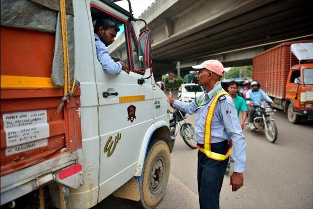 Daya Shankar Singh Yadav, an employee of security company G4S India, helps the Gurgaon traffic police in managing vehicles.