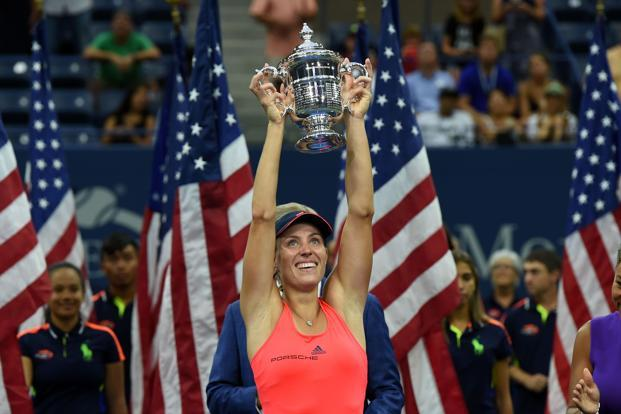 Angelique Kerber of Germany holds up her winning trophy after defeating Karolina Pliskova of Czech Republic in their 2016 US Open Women's Singles final match at the USTA Billie Jean King National Tennis Center in New York Saturday. Photo: AFP